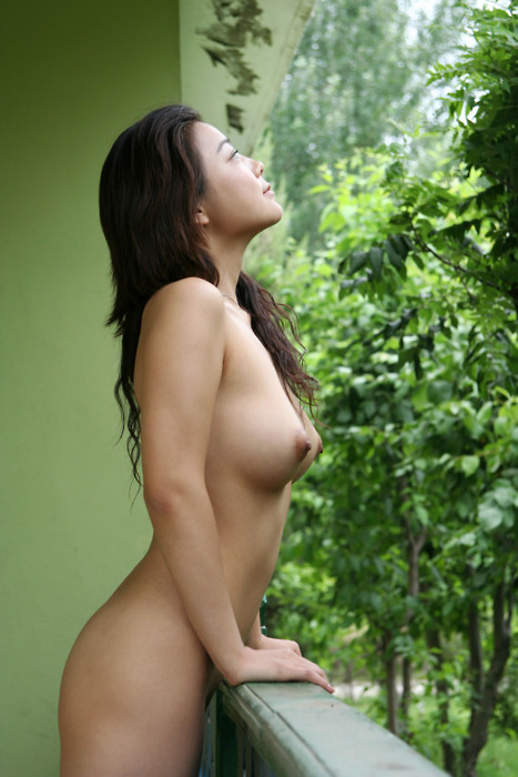 asian woman balcony